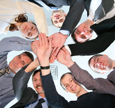 image of a group of people working together during a team building exercise
